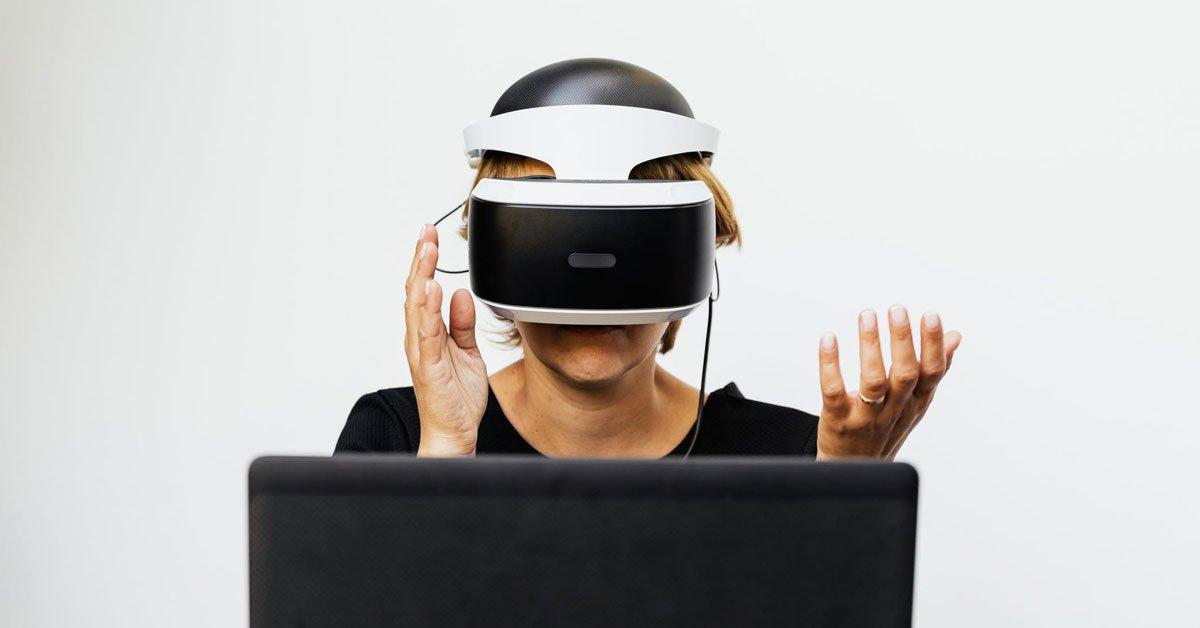 woman using virtual reality headset at work