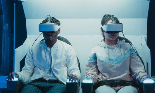 two employees training through virtual reality